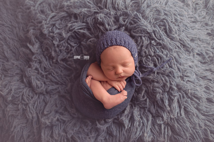 How to pose a swaddled newborn