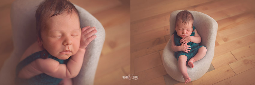 newborn boy posed on baby sized posing chair in knit overalls