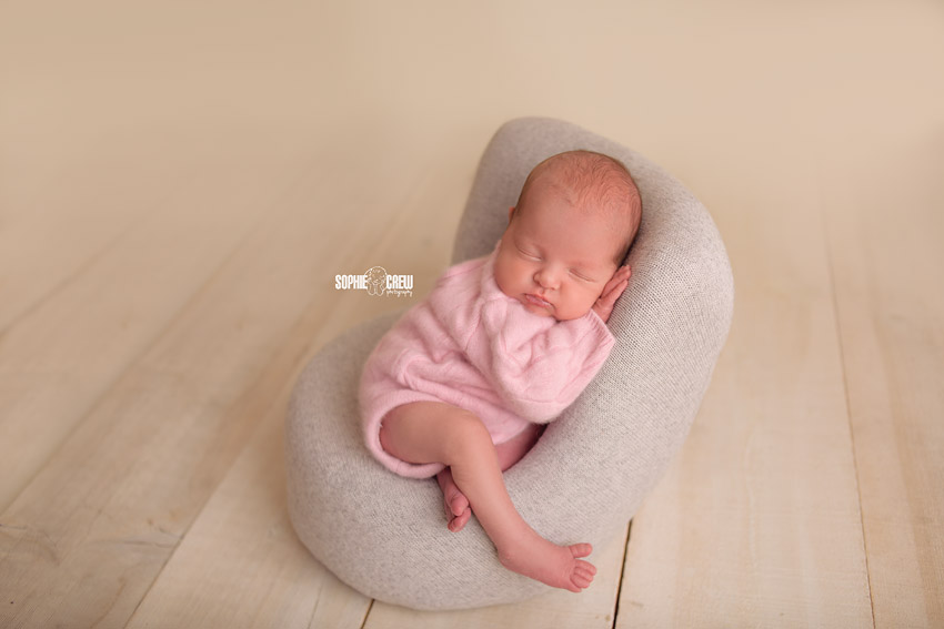 Newborn on Posing Pod with romper