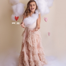 Girl catches puffy cloud for Valentines Day Session