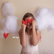 Photography mini session Valentines with two red felt hearts