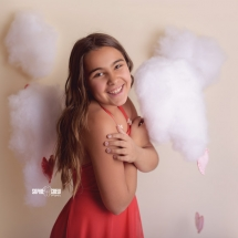 Tween girl wearing red Dollcake dress poses for Valentines Day San Diego photos
