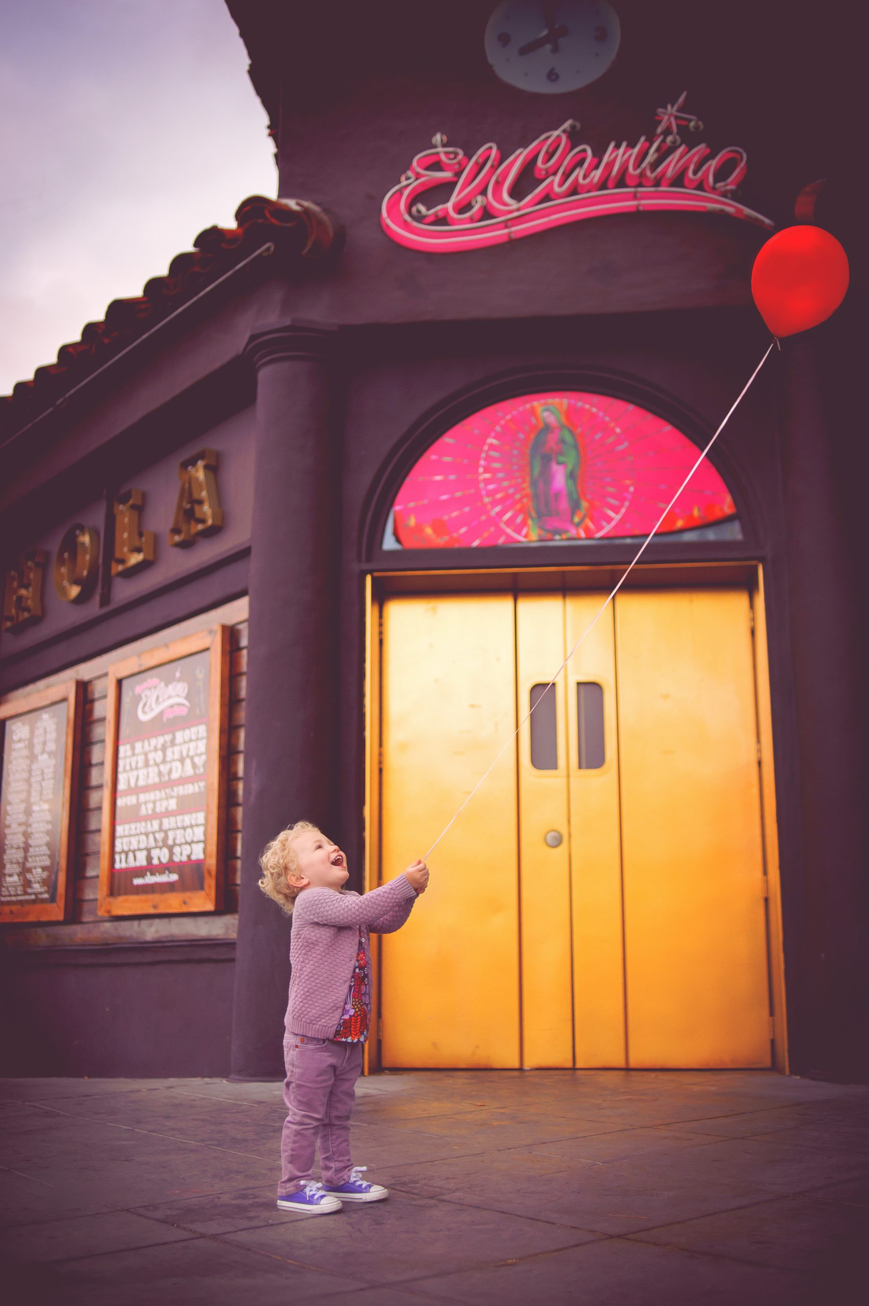 Fun urban family photo shoot in front of El Camino Restaurant in Little Italy, San Diego