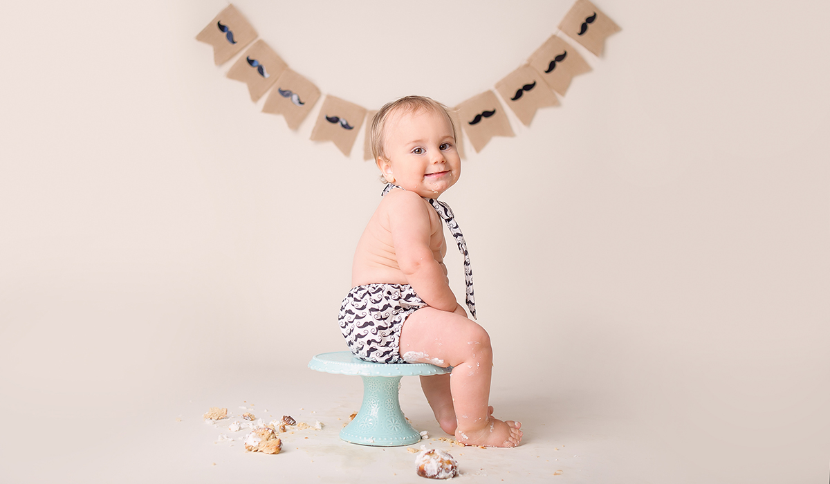 funny cake smash photos cute babies San Diego baby cake photographer