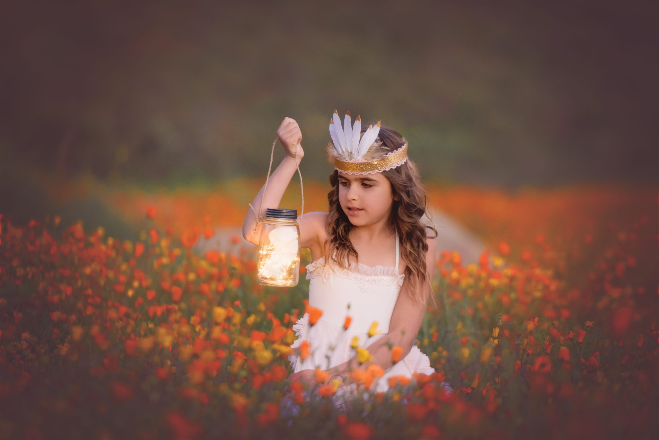 Little girl holding lantern as a prop in San Diego during her wildflower mini session