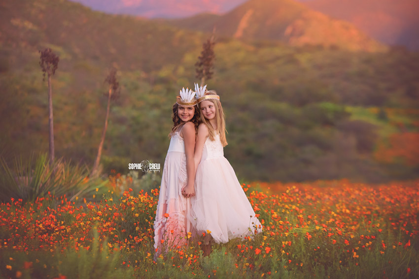 Two girls in valley of orange flowers during the superbloom in San Diego, CA