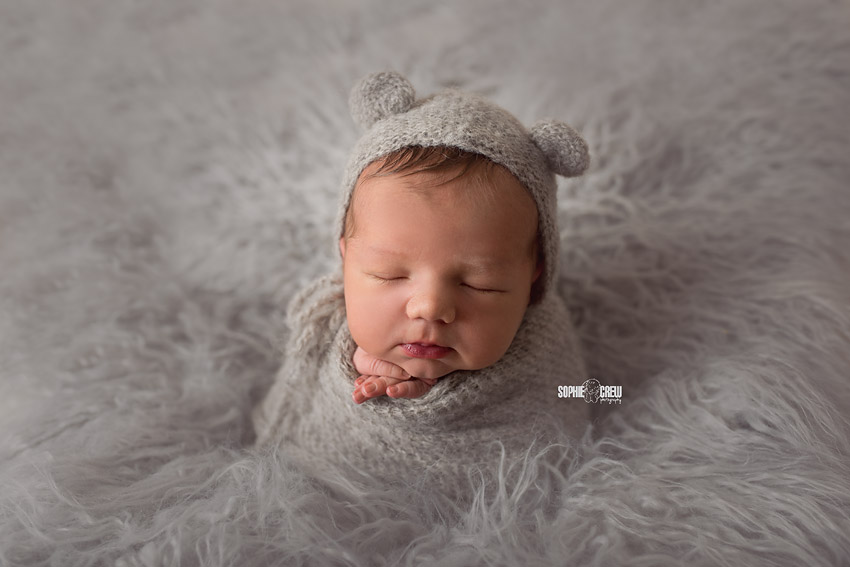 Gray flokati, bonnet and wrap for baby boy potato sack pose