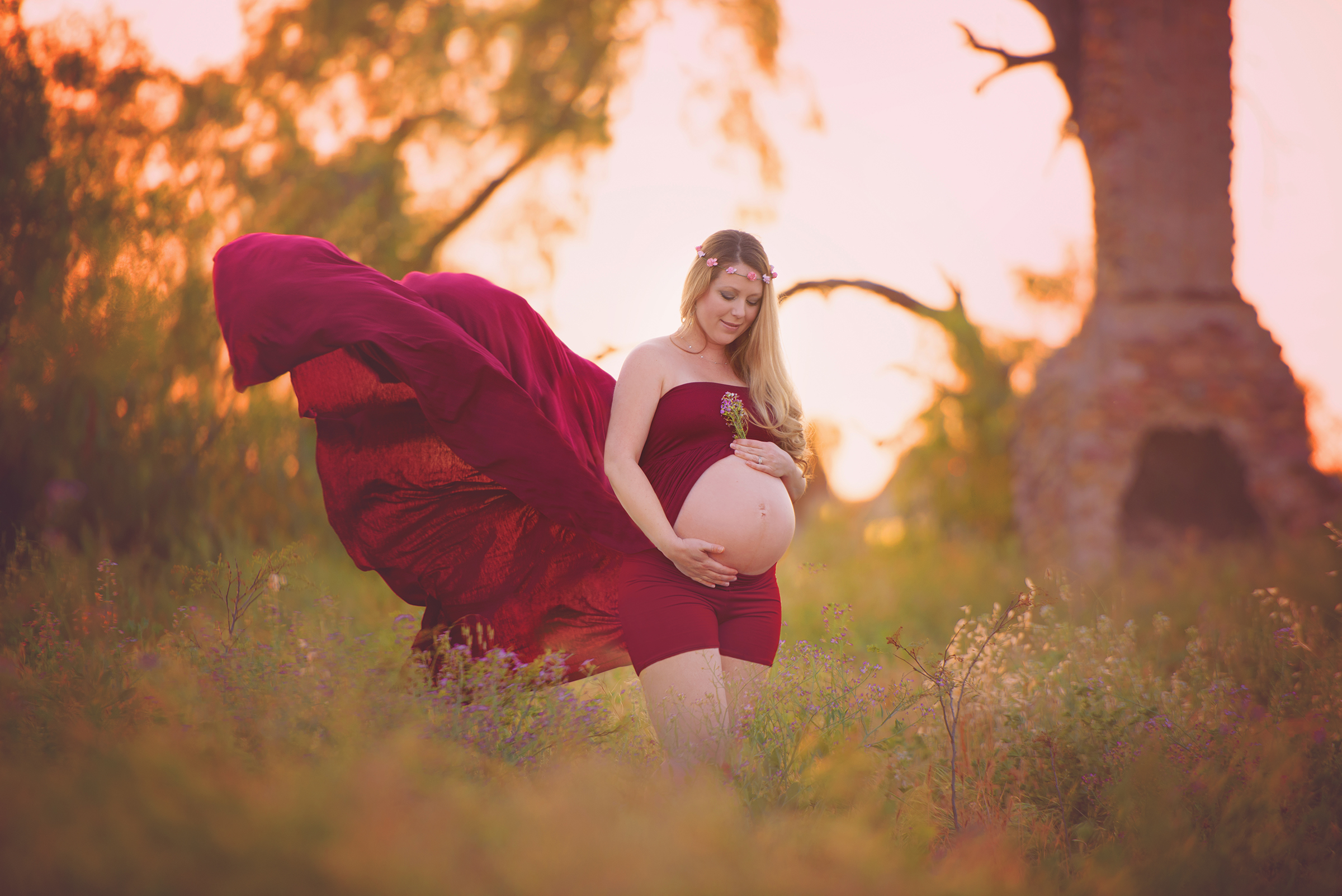Maternity photography at field in San Diego with old, rustic fireplace