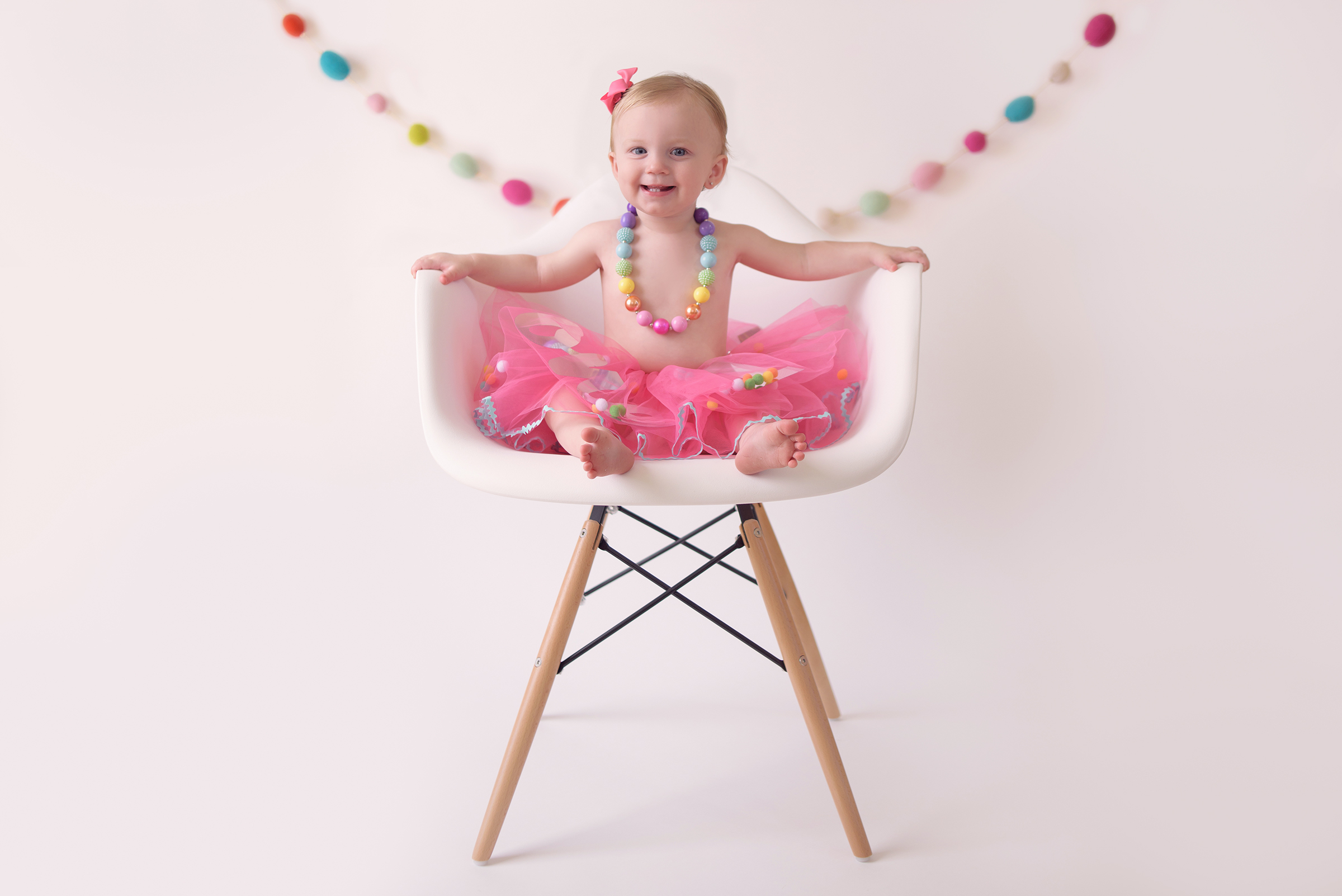 cake smash and baby portraits for one year old birthday in studio san diego, ca