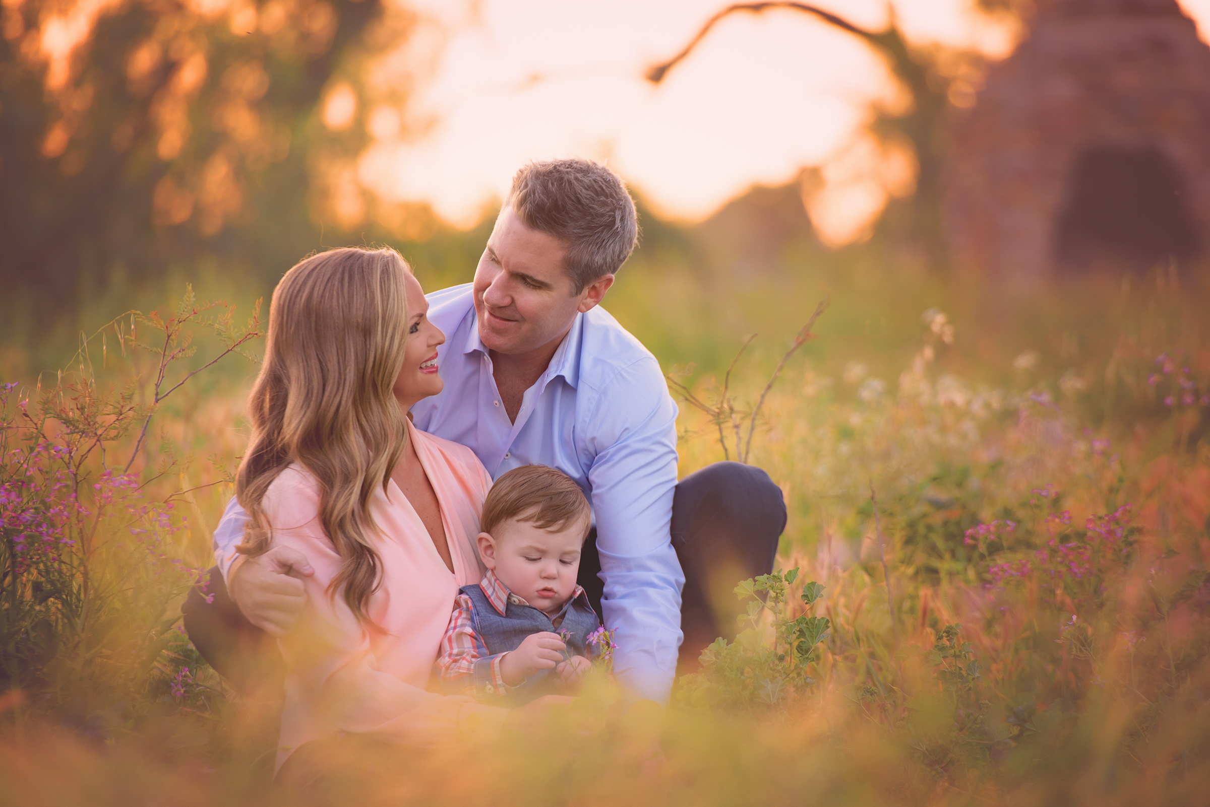A family poses for a portrait session in the spring for San Diego photographer Sophie Crew