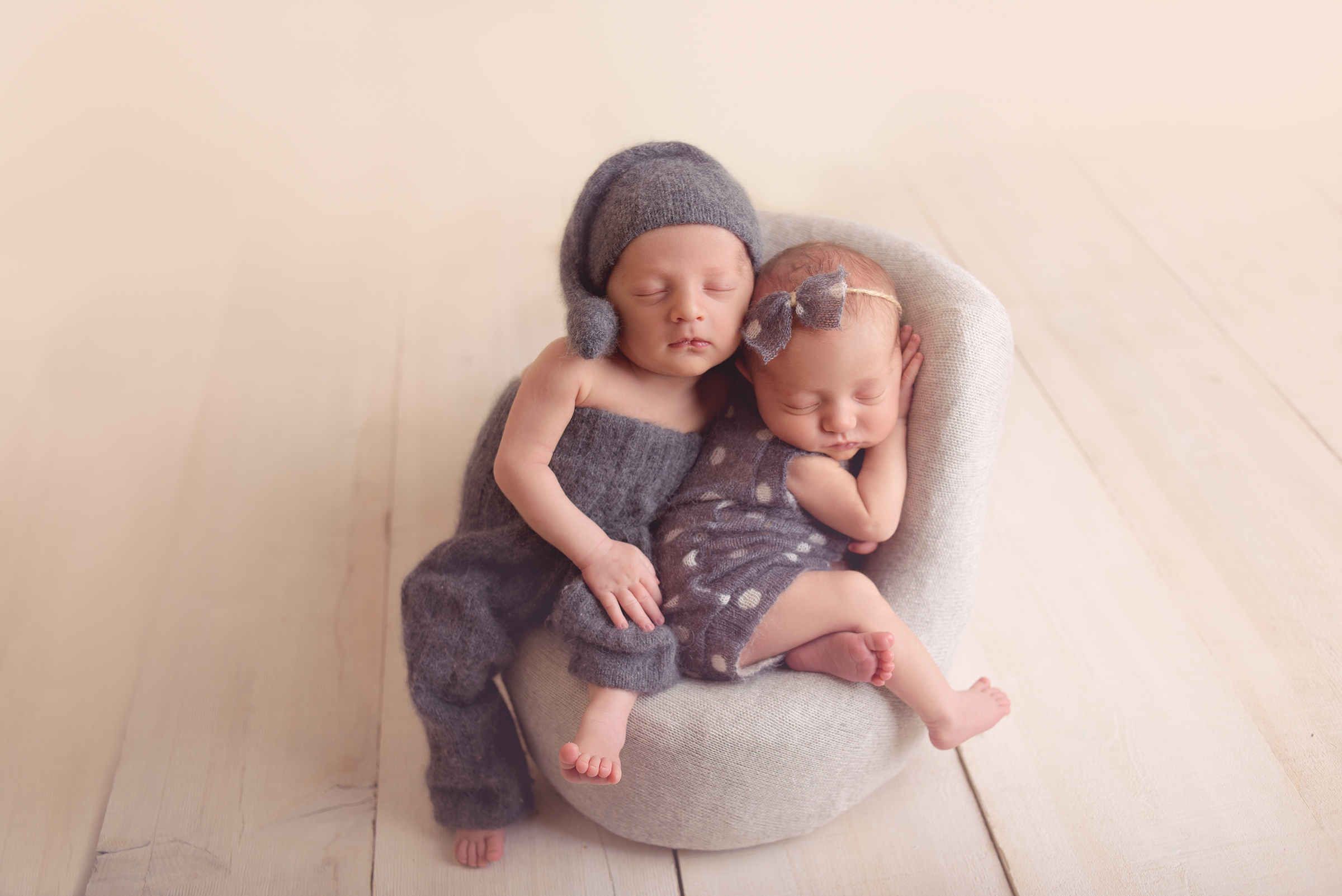 Twin newborn photographer in San Diego poses a boy and girl baby pair in DIY posing pod