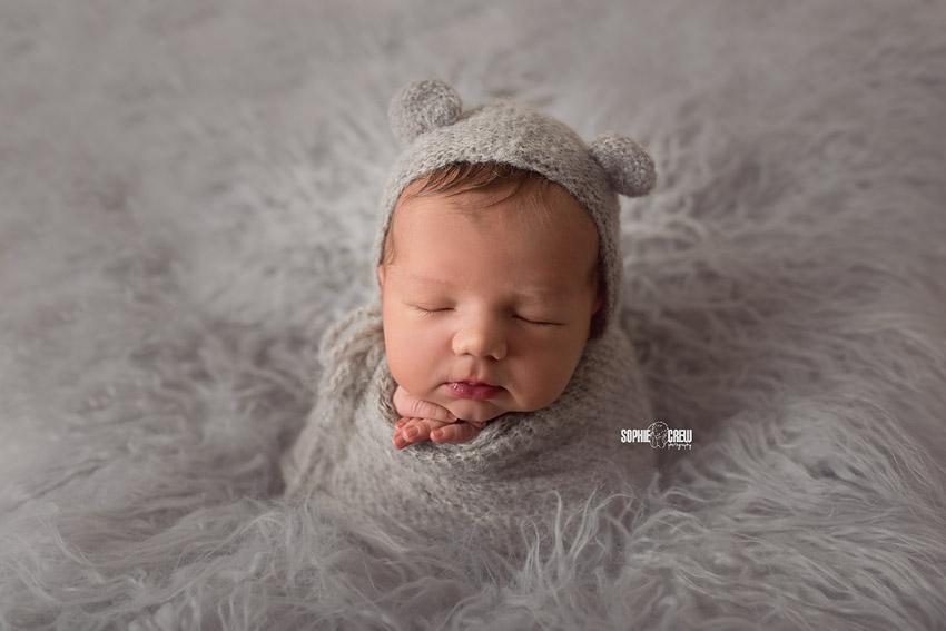 Gray flokati, bonnet and wrap for baby boy potato sack pose